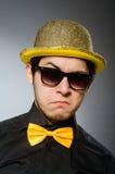 有葡萄酒帽子的滑稽的人 免版税图库摄影