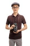 有葡萄酒成套装备和一台老照相机的十几岁的男孩 免版税库存照片