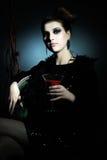 有葡萄酒杯的美丽的女孩 图库摄影