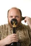 有葡萄酒电话的人 库存照片