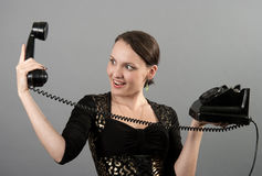 有葡萄酒电话的女孩 免版税库存图片