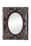 有葡萄酒的镜子装饰了框架 免版税库存图片