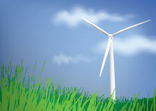 有蓝天和绿草的风轮机 免版税图库摄影