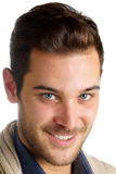 有蓝眼睛的微笑的年轻人 免版税图库摄影
