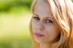 有蓝眼睛的a女孩 免版税图库摄影