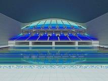 有蓝色位子的室内奥林匹克大小游泳池竞技场 库存照片