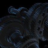 有蓝色光的黑暗的齿轮在黑背景 库存照片