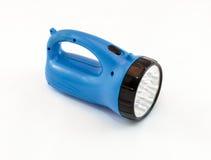 有蓝色塑料盒的LED手电在白色背景 免版税库存图片