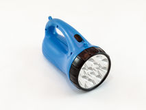 有蓝色塑料盒的LED手电在白色背景 库存照片
