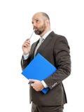 有蓝色文件夹的商人 免版税库存图片
