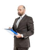 有蓝色文件夹的商人 库存图片