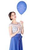 有蓝色气球的妇女 库存照片