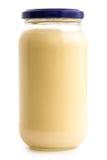 有蓝色盒盖的玻璃蛋黄酱瓶子在白色 库存照片