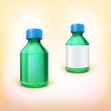 有蓝色盒盖的绿色医疗瓶 免版税库存照片