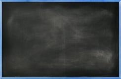 有蓝色边界的织地不很细黑板 免版税库存照片