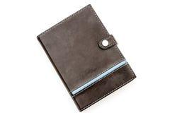 有蓝色stiching和小条的减速火箭的被称呼的棕色皮革笔记本 免版税库存照片
