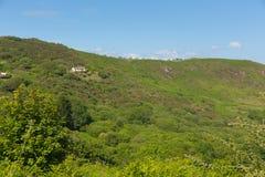 有蓬卡车在峭壁顶部有三峭壁海湾看法Gower威尔士英国 免版税库存照片