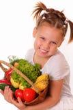 有蔬菜和水果的美丽的小女孩 免版税图库摄影
