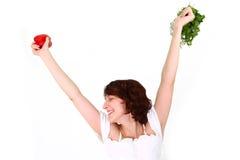 有蔬菜的愉快的少妇 免版税图库摄影
