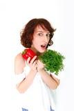 有蔬菜的愉快的少妇 免版税库存照片