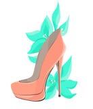 有薄荷的花的珊瑚桃红色高跟鞋 库存照片
