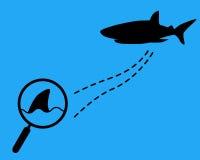 有虚线和鲨鱼的放大镜 库存照片