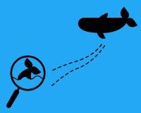 有虚线和鲸鱼的放大镜 库存照片