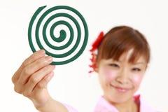 有蚊子卷的日本妇女 库存照片