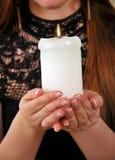 有蜡烛的圣诞节妇女 库存照片