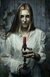 有蜡烛的虚拟女孩 免版税图库摄影