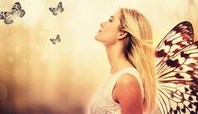 有蝴蝶翼的美丽的少妇 图库摄影