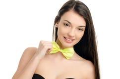 有蝶形领结的女孩。 免版税库存图片