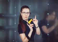 有螺丝刀的女实业家 免版税库存照片