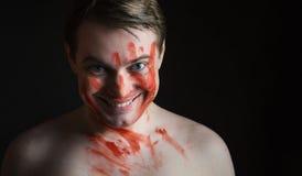 有血液的人在他的面孔 库存照片