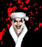 有血液的邪恶的圣诞老人小丑 库存照片