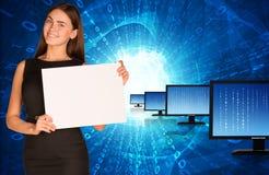 有行显示器和发光的女实业家 免版税库存图片