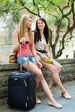 有行李的两名愉快的妇女 免版税库存照片