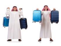 有行李的阿拉伯人在白色 图库摄影