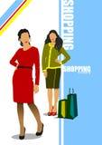 有袋子的两个逗人喜爱的购物夫人 免版税库存照片