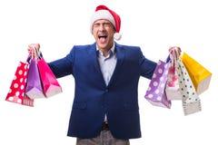 有袋子的年轻人在白色背景的圣诞节购物以后 免版税库存图片