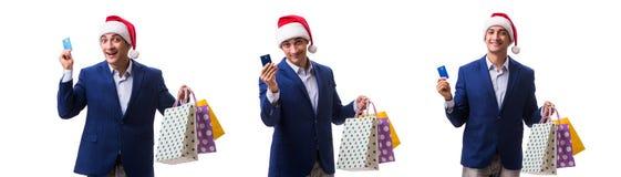 有袋子的年轻人在白色背景的圣诞节购物以后 库存图片