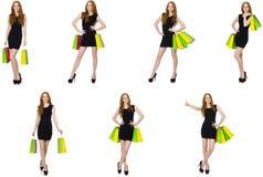 有袋子的年轻女人在shopaholic概念 免版税库存照片
