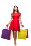 有袋子的移动的少妇,购物的概念,隔绝在白色背景 图库摄影