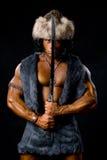 有被上升的剑的男性战士。 免版税库存照片