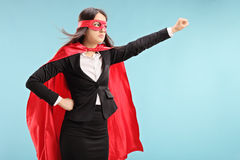 有被举的拳头的女性超级英雄 图库摄影
