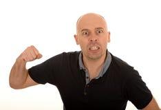 有被举的拳头的恼怒的人 免版税库存图片