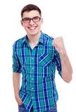 有被举的拳头的愉快的人 免版税库存图片