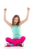 有被举的胳膊的呼喊的女孩 免版税库存照片