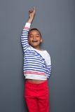 有被举的胳膊的愉快的年轻男孩 库存图片