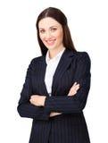 有被交叉的双臂的微笑的新女实业家 库存图片